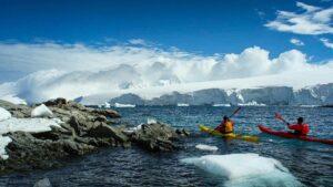 Kayaking Between Antarctic Icebergs Wall Mural